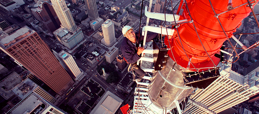 Tower climber servicing the broadcast masts at the John Hancock Center in Chicago