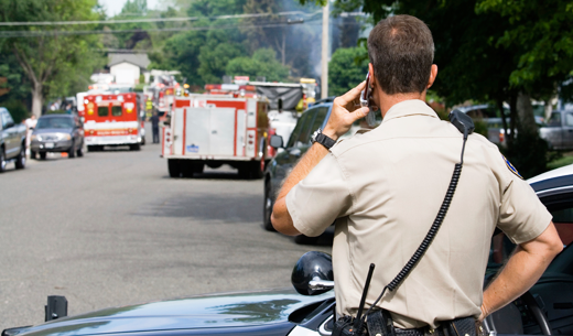 Law Enforcement Officer communicating at an accident scene